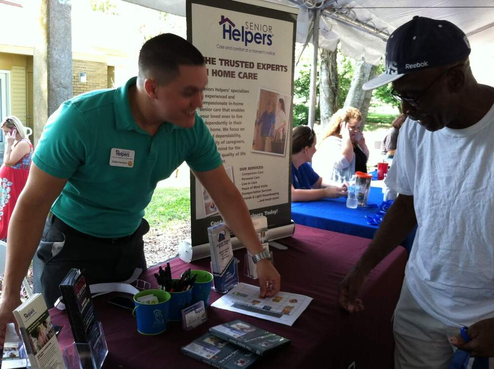 attendee at resident fair visiting vendor booth